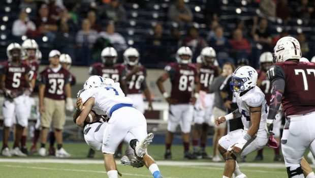 Tigers Qualify for Playoffs with 58-28 Rout of Midland Lee