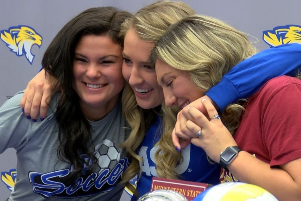 frenship soccer players hug after signing with different colleges