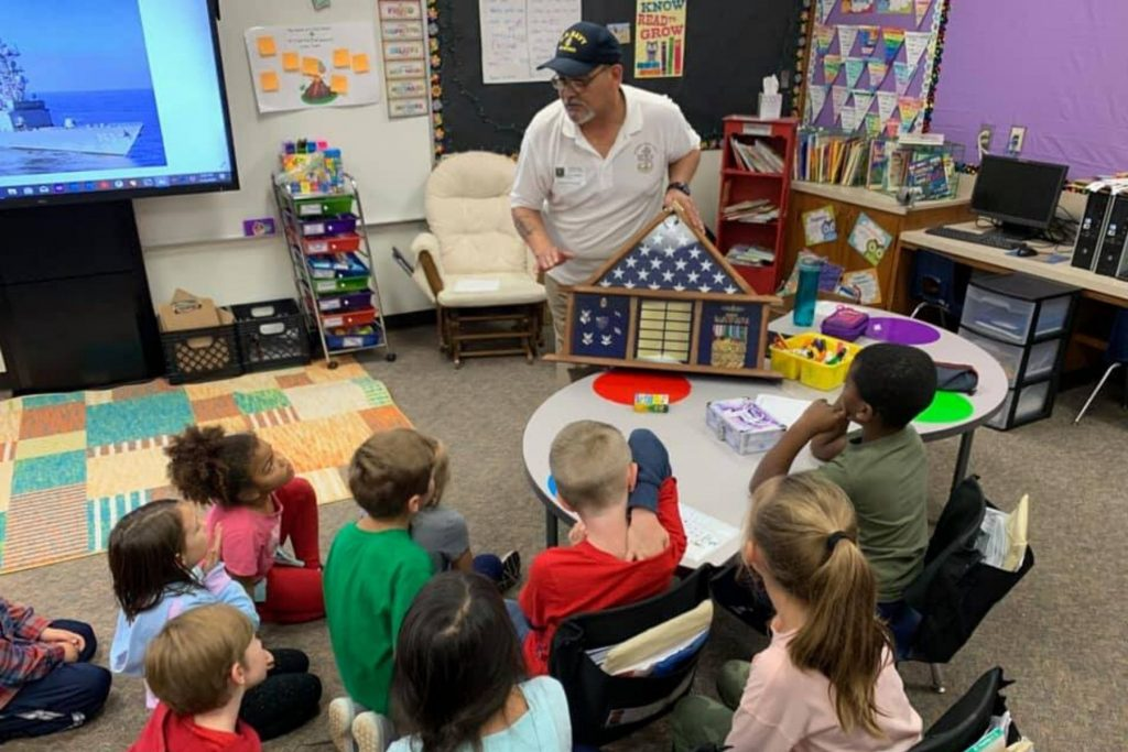 veteran joe lafuente talks about veterans day to crestview students
