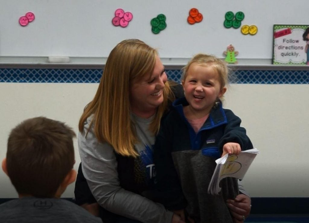 Kenzie Haulk reads to a second grade class in braille