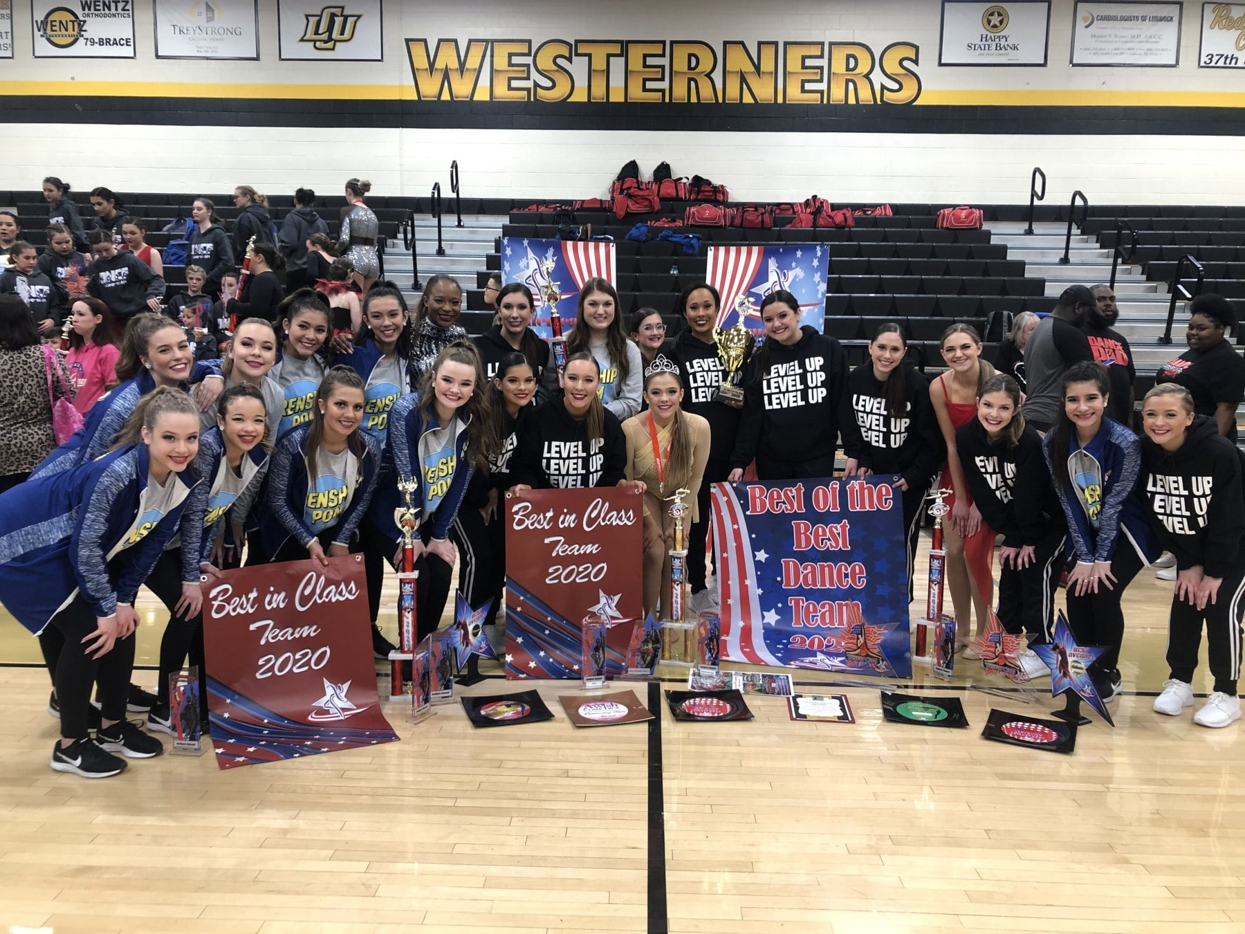 frenship pom squads pose with awards at the american dance and drill competition