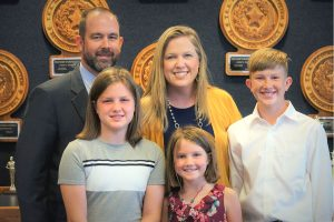 Andrew cox and his wife Susan and three children